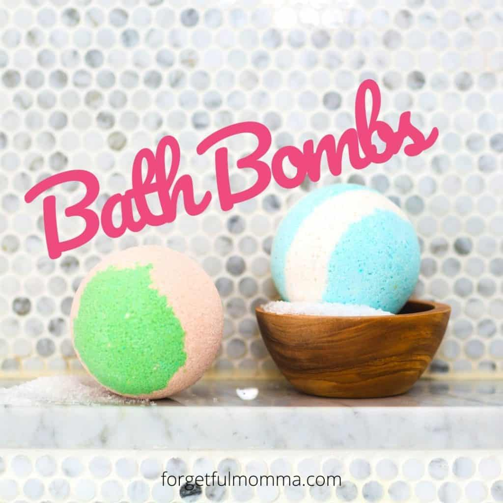 DIY bath bomb recipes - 2 bath bombs sitting on tub edge