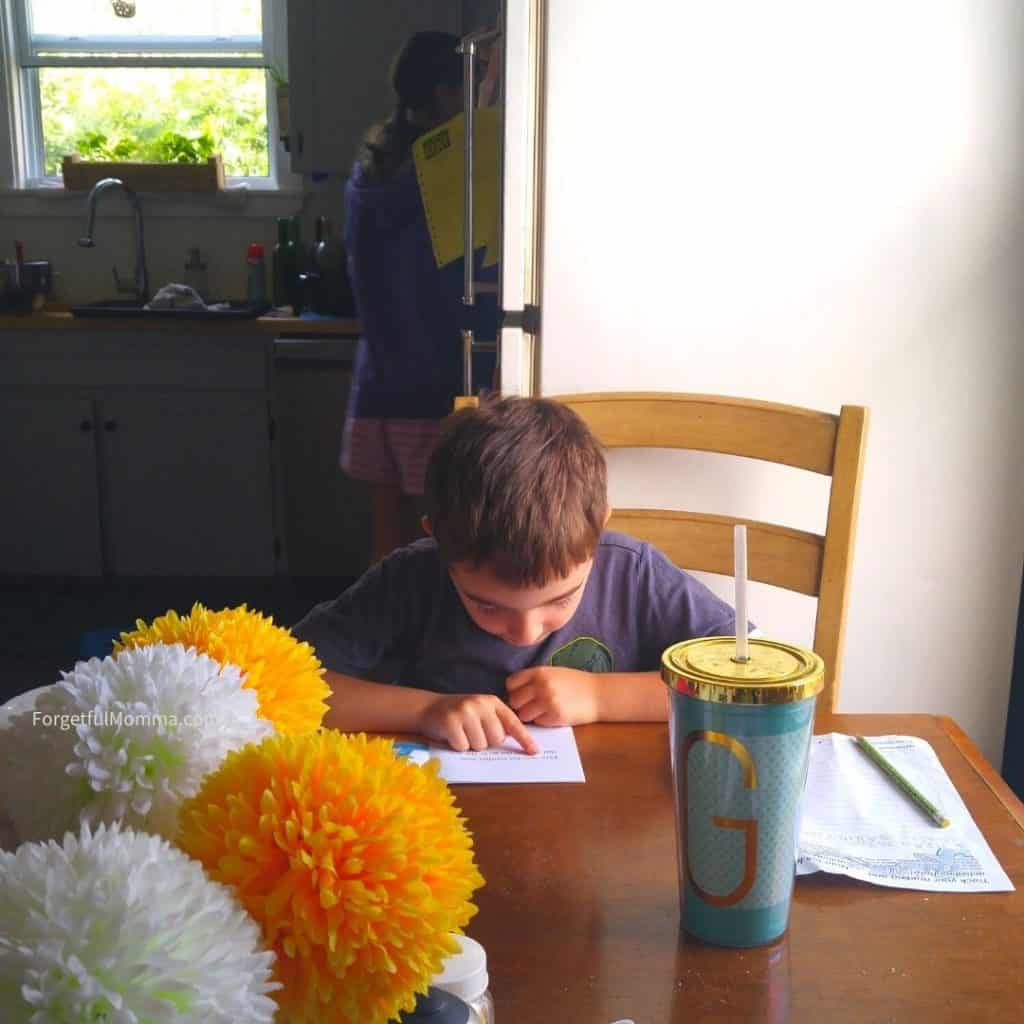 Reading & Language Arts Curriculum - boy reading at table