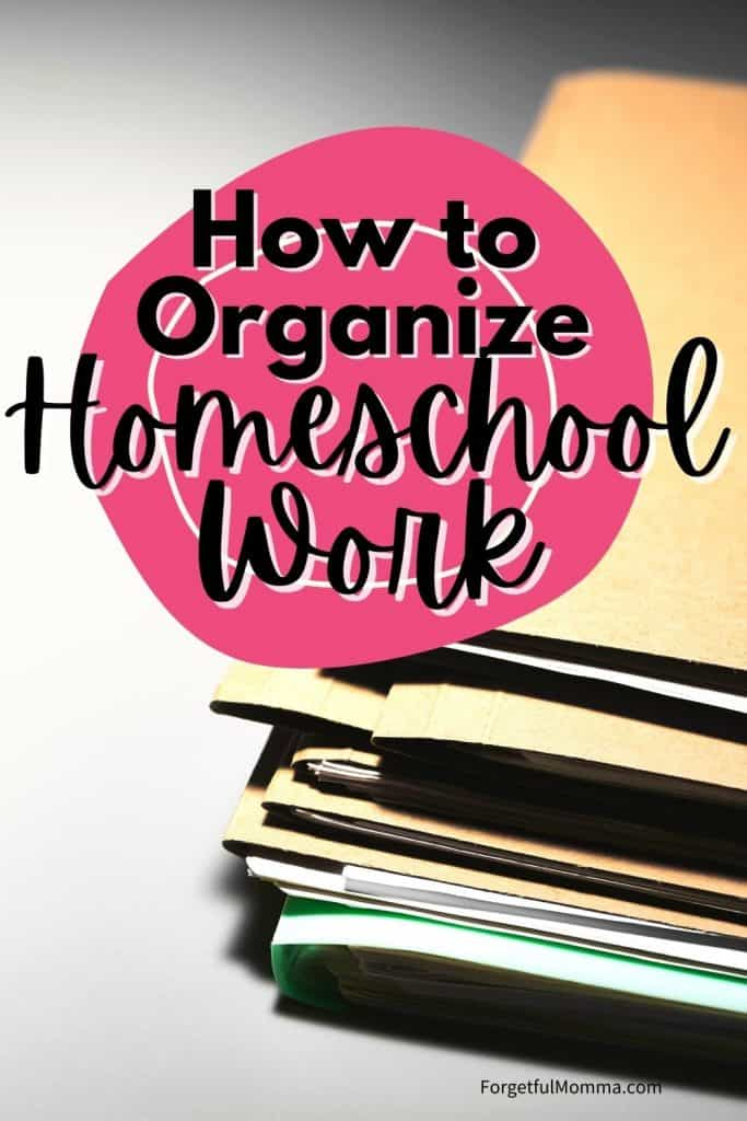 How to Organize Homeschool Work - files laying on desk with text overlay